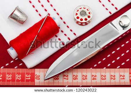 sewing tools and fabric - stock photo