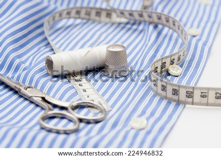 Sewing tools on a white background. - stock photo