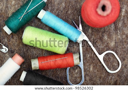 Sewing tools on a woolen fiber. Close-up color photo - stock photo