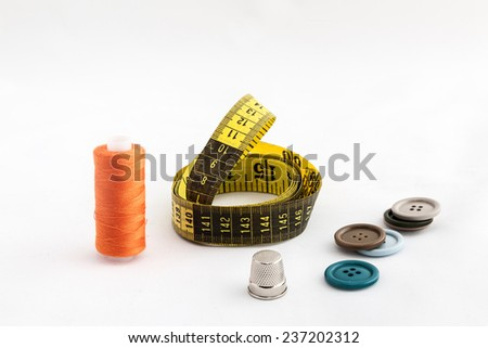 Sewing utensils, scissors, threads and buttons colors isolated on white background - stock photo