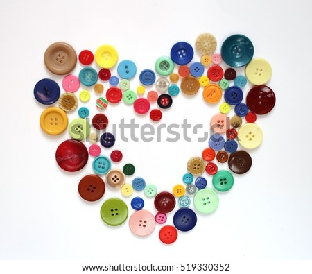 sewing with love. Heart of colorful buttons isolated on white background 1