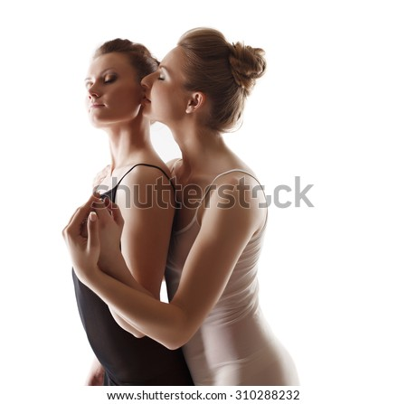 Sex concept. Girl gently kisses her partner in ear - stock photo