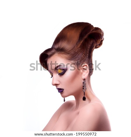 Sexual adult girl with creative make up on white background in studio