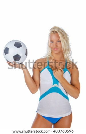 Sexual blond fitness woman posing with soccer ball.