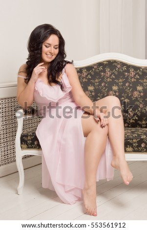 Sexual emotional attractive young woman posing in a boudoir