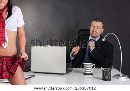 Sexual harassment. Sexy woman is seducing her boss at office - stock photo