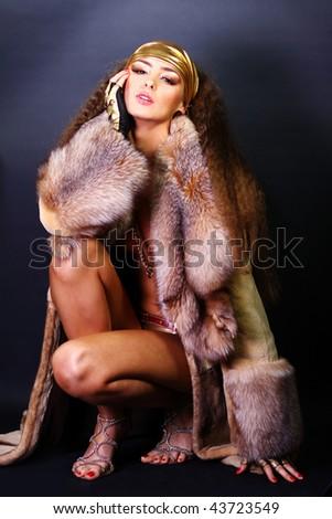 Sexual model in a fur coat - stock photo