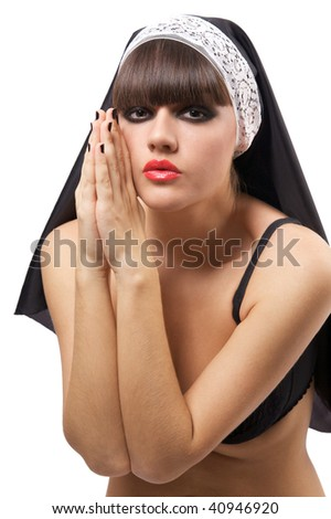 Sexual nun prays. Isolated over white background - stock photo