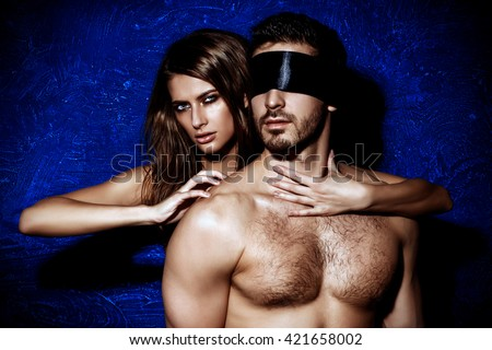 Sexual passionate couple play in love games. BDSM. - stock photo