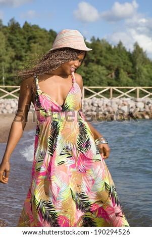 Sexy African American woman having fun on a beach - stock photo
