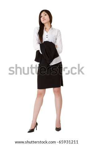 Sexy and attractive business woman holding coat isolated over white.