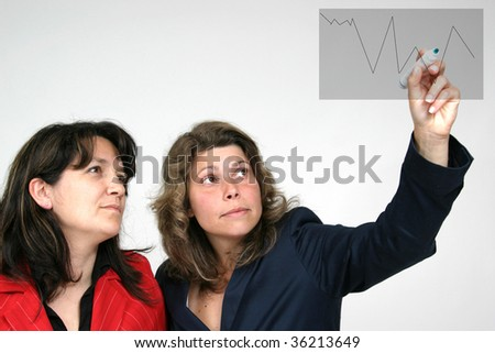 sexy and beautiful woman designing and writing - stock photo
