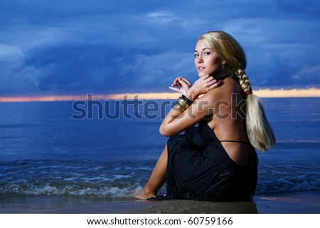 sexy and luxury woman on sunset backgroung - stock photo