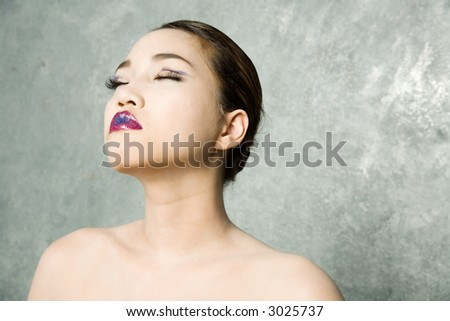 Sexy asian woman in makeup - stock photo