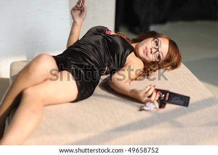 sexy asian woman lying and look her phone - stock photo