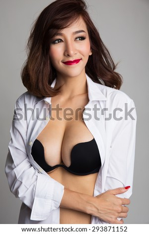 Sexy asian woman showing her sexy breast in black bra or  lingerie with shirt opened - stock photo