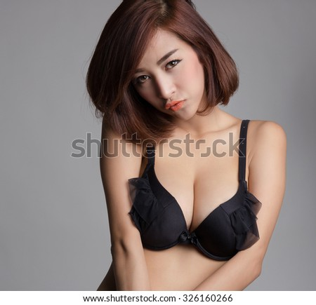 Sexy asian woman wearing black bra or lingerie with big boobs - stock photo
