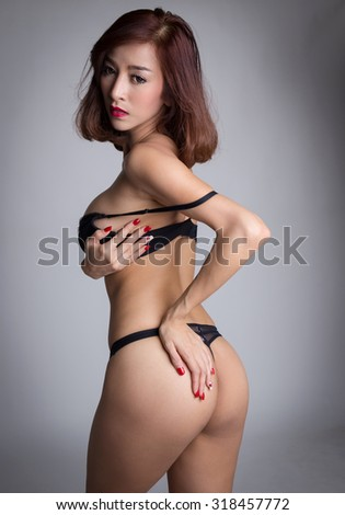 Sexy asian woman wearing black lingerie posing - stock photo