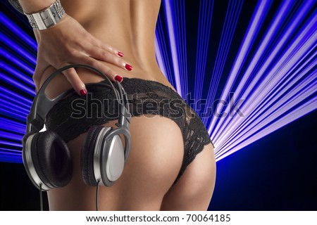 sexy ass with dj headphones over lasers - stock photo