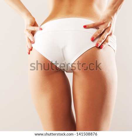 sexy ass young woman. studio - stock photo