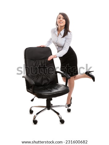 Sexy assistant inviting to relax on a office chair - stock photo