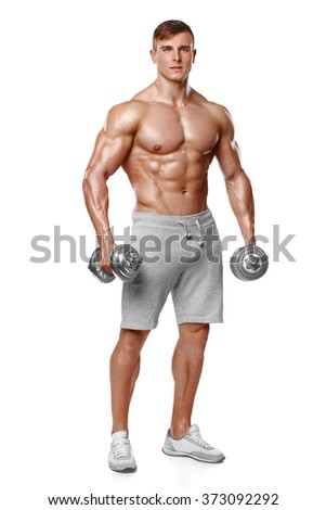 Sexy athletic man showing muscular body with dumbbells, full length, isolated over white background. Strong male naked torso abs - stock photo