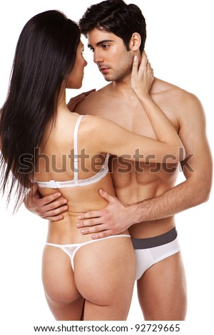 Sexy attractive couple standing in their underwear looking in to each others eyes, studio on white - stock photo