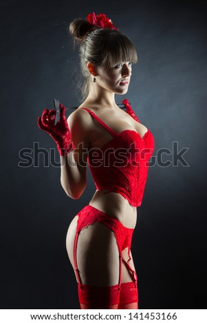 Sexy attractive girl in red lingerie holding leather stick - stock photo