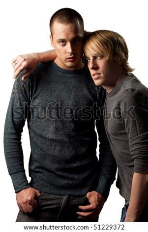 Sexy, attractive young gay couple, isolated studio image - stock photo