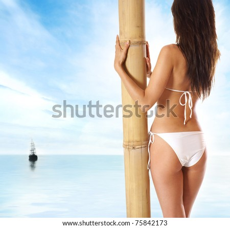 Sexy back of young beautiful brunette isolated on white - stock photo
