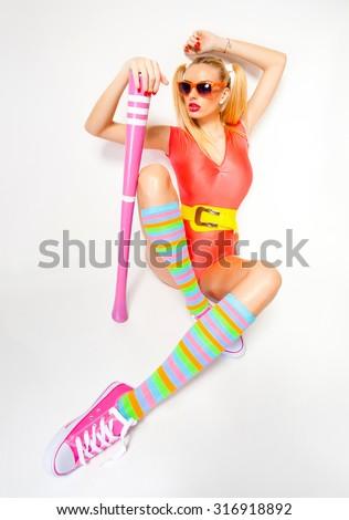 sexy baseball girl wearing colorful clothes posing with a baseball bat - stock photo