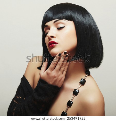 Sexy Beautiful Brunette Girl. Healthy Black Hair. Retro Bob Haircut - stock photo