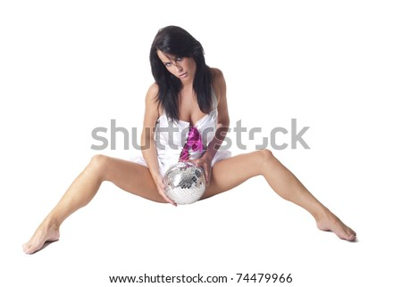 Sexy beautiful lady sitting on a floor with discoball - stock photo