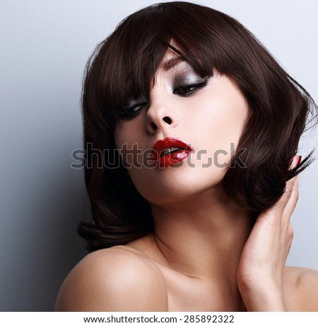 Sexy beautiful woman posing with black short hairstyle and red lipstick. Closeup portrait - stock photo