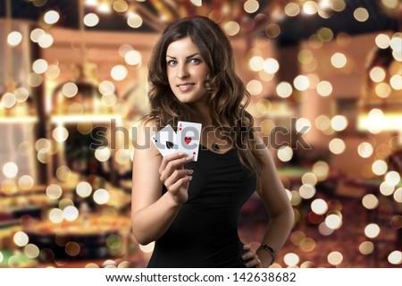 Sexy beautiful young girl in casino (background bokeh) - stock photo