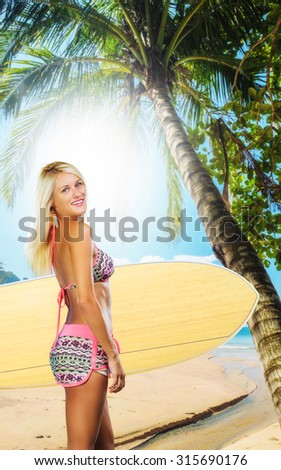 sexy beautiful young woman surfer girl in bikini with white surfboard at a beach - stock photo