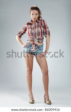 sexy beautiful young woman wearing hot pants - stock photo