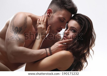 Sexy beauty couple posing in studio.Fashion colors.
