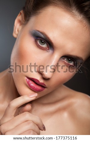 Sexy Beauty Girl with Red Lips. Provocative Make up. Luxury Woman with Blue Eyes. Fashion Brunette  Gorgeous Woman Face. Long Hair - stock photo