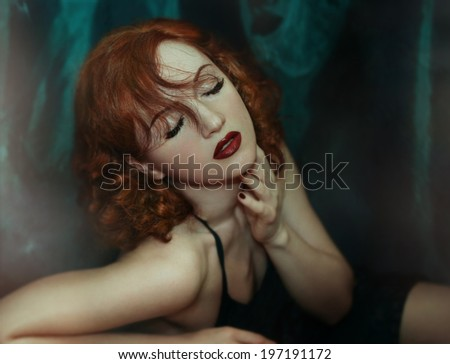 Sexy Beauty Red haired Woman with dark Red Lips and Nails. Provocative Make up. Luxury Woman with long Eyelashes. Fashion Red haired Portrait. Gorgeous Woman Face. Red Hair - stock photo