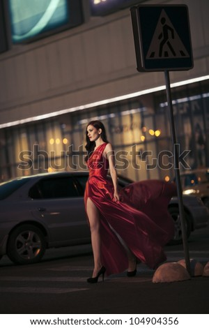 Sexy beauty woman in fluttering red dress - motion shot