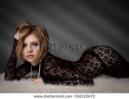Sexy beauty woman lie on a fur  - stock photo