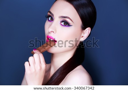 Sexy Beauty Woman Portrait. Professional Holiday Make up for Brunette. Beautiful Fashion Model Girl. Long Hair. Creative Hairstyle, Makeup and Nail Polish - stock photo