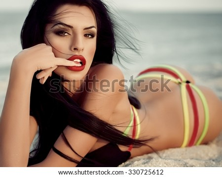 Sexy bikini girl posing at beach - stock photo