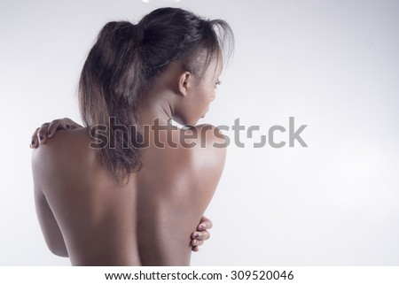 Sexy black woman from back on grey background