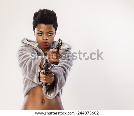Sexy black woman with guns - stock photo
