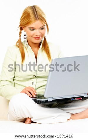 Sexy blond business woman using laptop computer