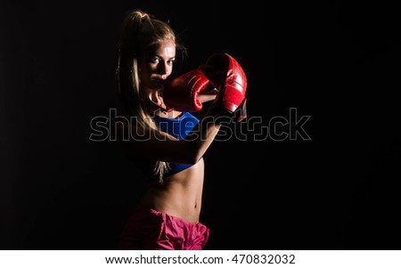 Sexy blond girl with black boxing gloves