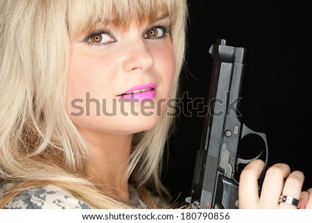 sexy blond with gun  - stock photo