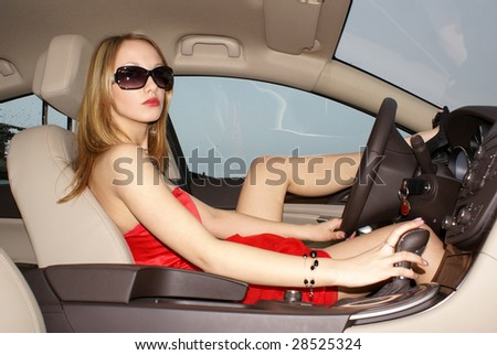 Sexy blond woman in a luxury car - stock photo